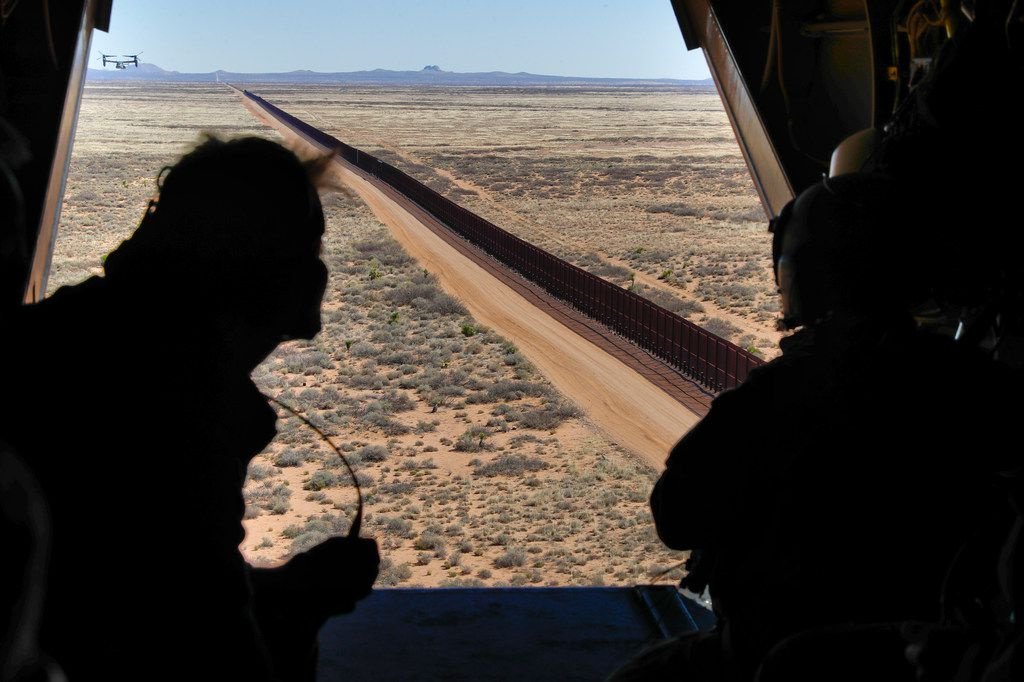 Acting Secretary of Defense Patrick Shanahan, left, aboard an Osprey aircraft during a tour of the US-Mexico border just west of El Paso, Texas, Saturday, Feb. 23, 2019. (AP Photo/Pablo Martinez Monsivais, pool)