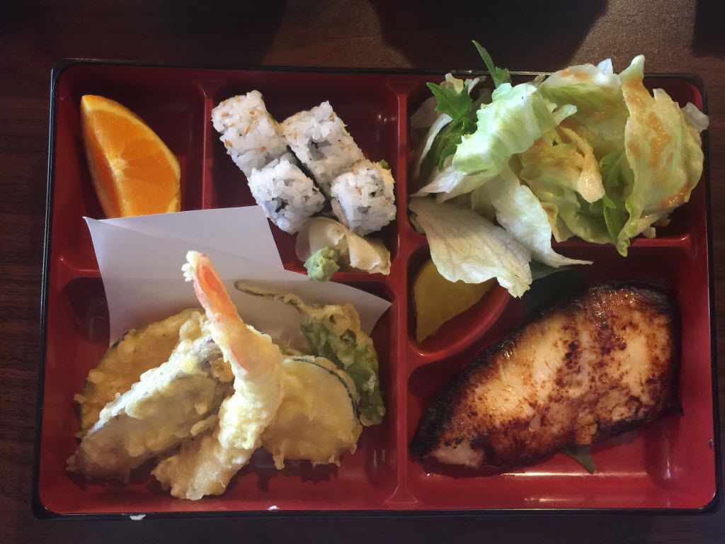 A bento box with tempura and black cod at Ken Japanese Bistro in Richardson. The $12.50 lunch ($9.50 plus a $3 upcharge for cod) includes miso soup to start, rice and orange wedges for dessert.