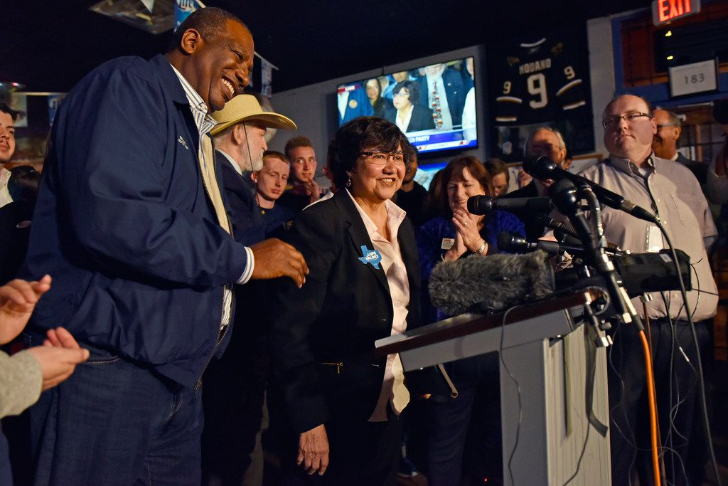 Senator Royce West, left, congratulates candidate for governor Lupe Valdez as she speaks at an election watch party for the Dallas County Democrats at Dallasite bar and billiards in Dallas, Tuesday, March 6, 2018.