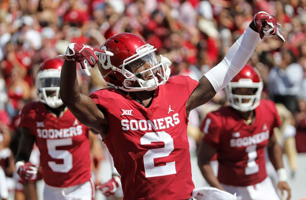Oklahoma Sooners wide receiver CeeDee Lamb (2) gestures after an OU touchdown in the second half during the University of Texas Longhorns vs. the Oklahoma Sooners NCAA football game at the Cotton Bowl in Dallas on Saturday, October 6, 2018. (Louis DeLuca/The Dallas Morning News)