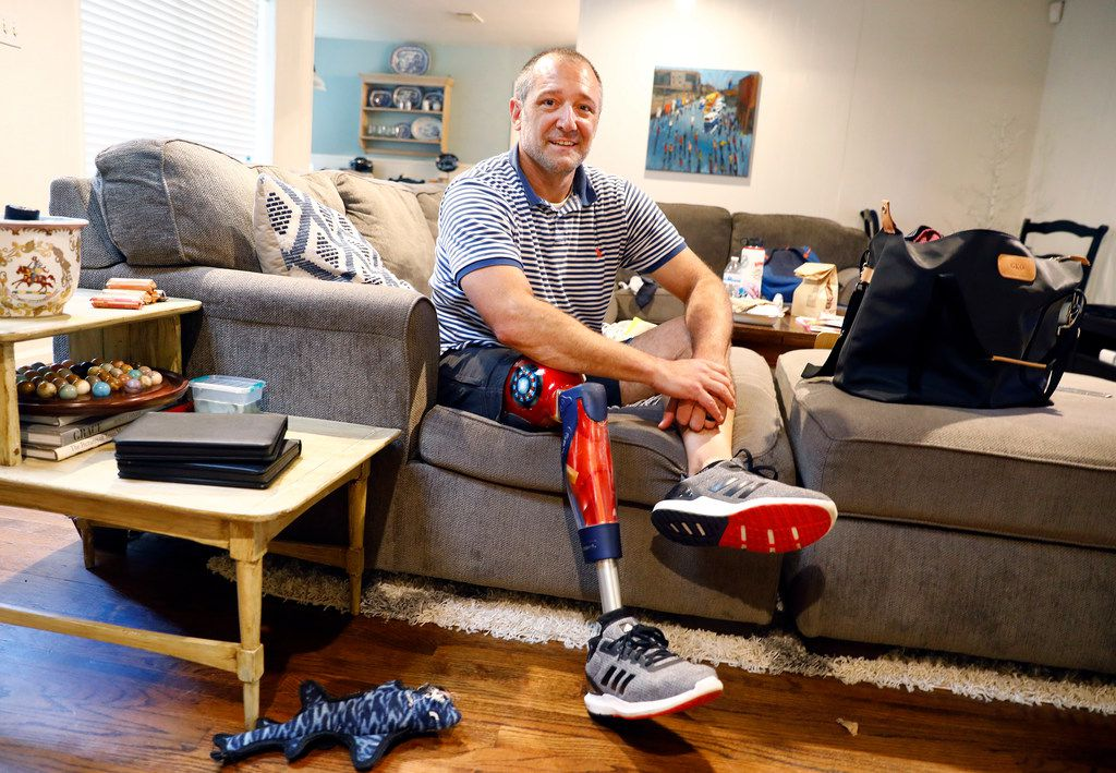 Five months ago, Michael Orlie could barely afford his family's monthly health insurance premiums, debating at month's end what he should pay first: the mortgage or the health care bill. After getting into shape and losing 20 pounds, the 46-year-old Arlington native needs a new $13,000 socket for his prosthetic leg and doesn't know if he can afford it. The socket for his prosthesis no longer fits. (Tom Fox/Staff Photographer)