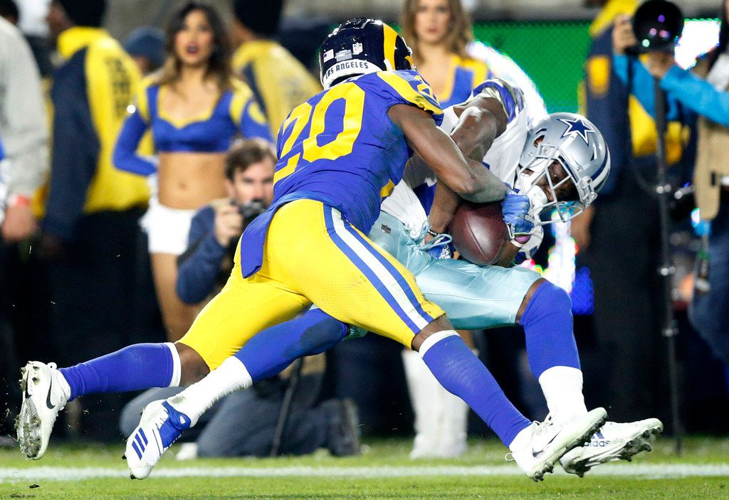 Dallas Cowboys wide receiver Michael Gallup (13) hangs onto a third quarter pass caught over the shoulder against Los Angeles Rams free safety Lamarcus Joyner (20) during their NFC Divisional Playoff game at Los Angeles Memorial Coliseum in Los Angeles, Saturday, January 12, 2019. Tye Cowboys lost 30-22.