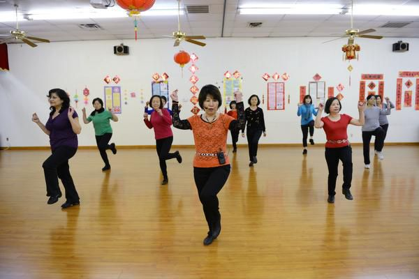 Instructor Juliet Lam (center) leads Asian woman in a line dancing class on Feb. 11 at the Dallas Chinese Community Center in Richardson. The nonprofit center has been a refuge for Asian immigrants in the Dallas area for almost three decades.