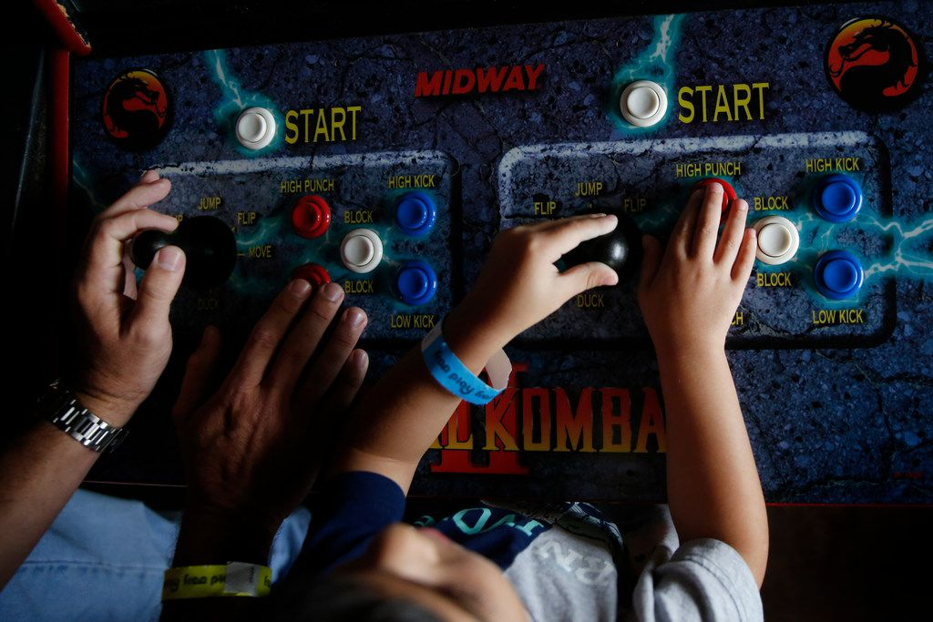 Jeff Wise (left) plays Mortal Kombat with his son Maxwell Wise, 4, at Free Play in Richardson.