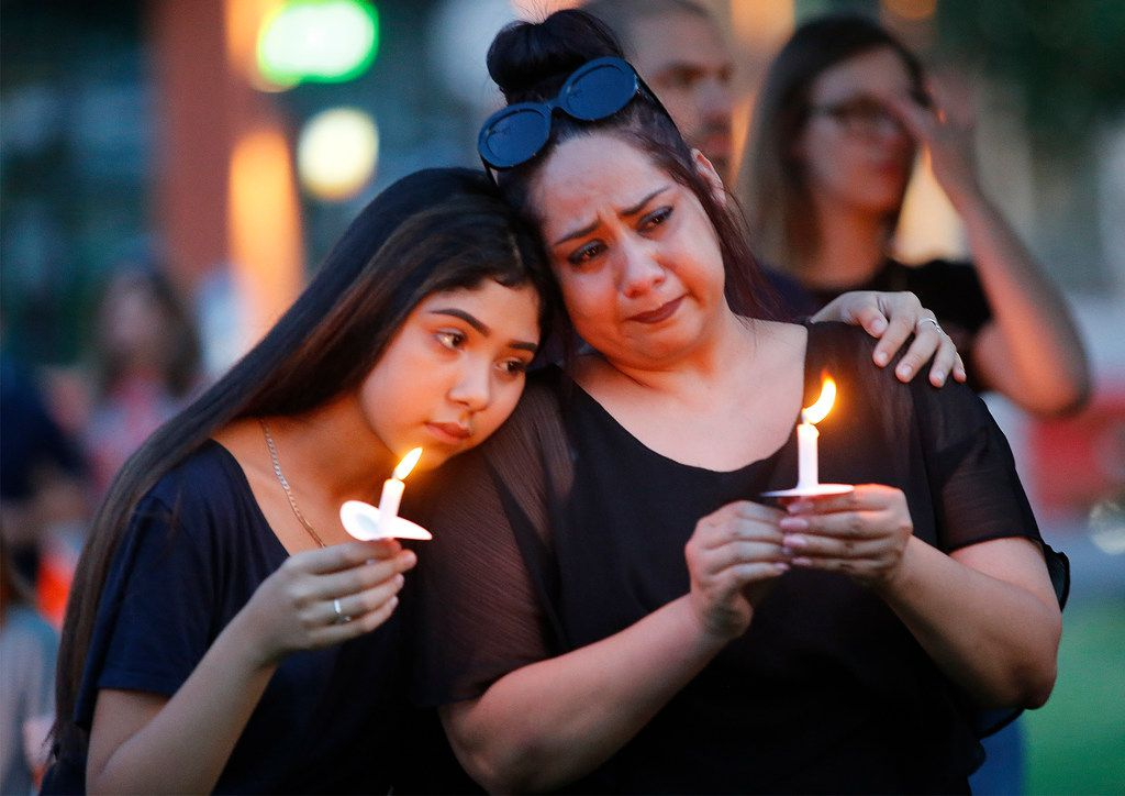Former El Paso residents Monica Martinez, right, of McKinney and her daughter Tory, 15, during a candlelight vigil held at Dr. Glenn Mitchell Memorial Park in McKinney on Monday, August 5, 2019, for the victims of recent shootings