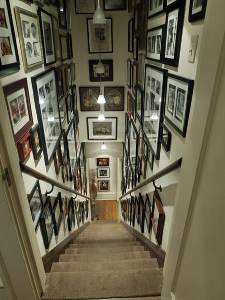 Only the photographs and light fixtures have changed over the years in the back staircase.