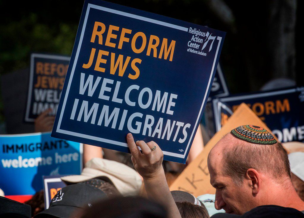 """Members of the Jewish community and their supporters hold a """"Jews Say #CloseTheCamps"""" protest and vigil to demand an end to the Trump administration's detention of migrants, refugees and asylum-seekers, outside the Metropolitan Detention Center in Los Angeles on Aug. 11, 2019."""