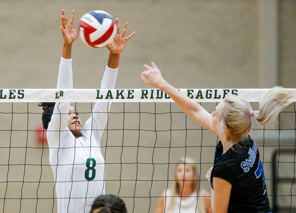 Mansfield Lake Ridge junior Lyric Stewart (8) attempts to block a spike by North Mesquite senior Abby McDaniel (7) during a high school volleyball game at Mansfield Lake Ridge High school in Mansfield, Tuesday, August 27, 2019. Lake Ridge won in three sets. (Brandon Wade/Special Contributor)