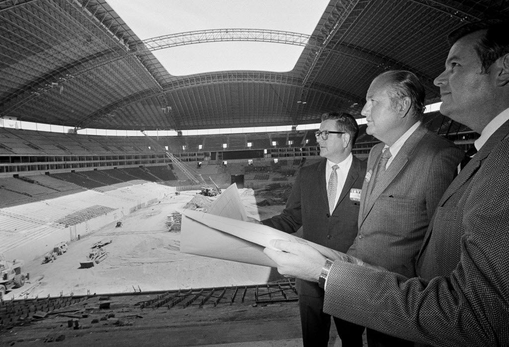 Dallas Cowboys owner Clint Murchinson, left, general manager Tex Schramm, center and Irving Mayor R. Dan Matkin, take a look at Texas Stadium on May 14, 1971. The $25 million arena would seat 65,000, with all seats under roof. The playing field was under open sky.