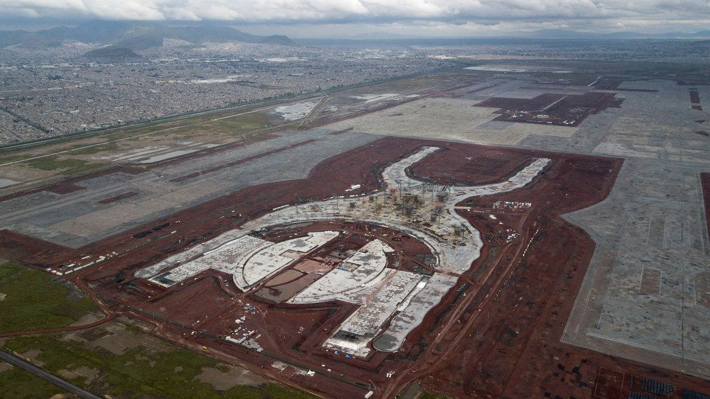 This Oct. 17, 2018 photo, a shows the construction of new airport in Texcoco, Mexico. The future of Mexico City's new airport, already about a third completed, comes down to a public vote this week in a political high-wire act by the country's president-elect that could shut down Mexico's largest infrastructure project in recent memory. (AP Photo/Miguel Tovar)
