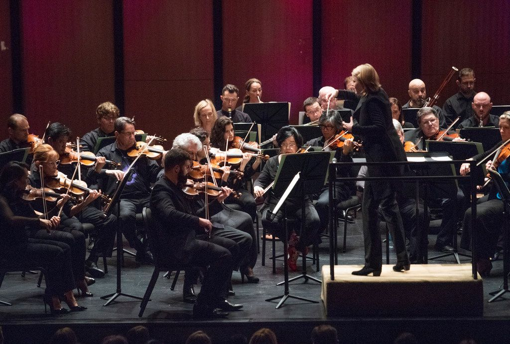 """Ruth Reinhardt conducts the Dallas Symphony Orchestra in """"Le Tombeau de Couperin"""" by Ravel, the first piece of a ReMix concert at Moody Performance Hall on Saturday."""