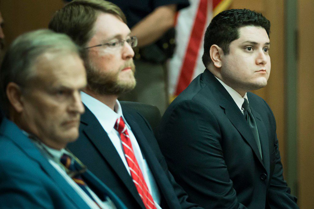 Enrique Arochi (far right) was found guilty of aggravated kidnapping. His defense attorneys are Keith Gore (center) and Steven Miears.