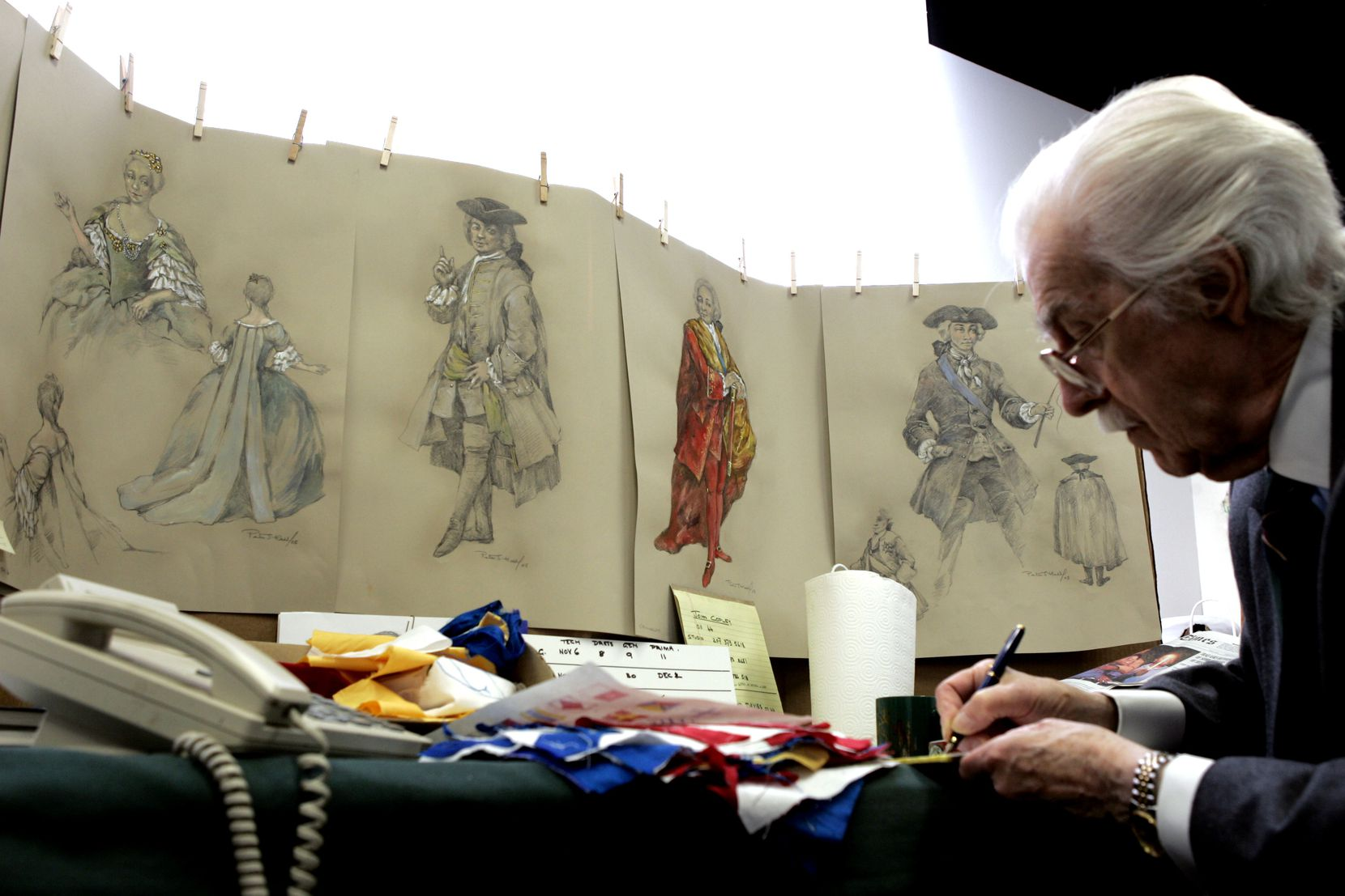 Costume designer Peter J. Hall works among his sketches in his office. Hall was the Dallas Opera's resident costume designer for four decades.
