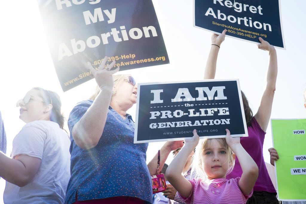 Six-year-old Nora of Harrisonburg, Va., joined her family at a demonstration against abortion on the steps of the U.S. Supreme Court on Monday in Washington, D.C. In a 5-3 decision, the court struck down one of the nation's toughest restrictions on abortion, a Texas law that women's groups said would have forced more than three-quarters of the state's clinics to close.