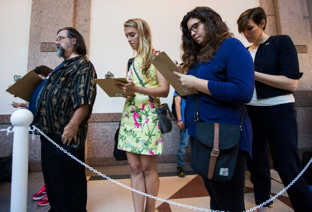 People stand in line to voice their opinions on the so-called bathroom bill at a public hearing on the fourth day of a special legislative session on Friday, July 21, 2017 at the Texas state capitol in Austin, Texas. Legislation being debated would restrict the bathrooms available for use to transgender people. Sen. Lois Kolkhorst, R-Brenham, said she authored the bill because she wants to protect the privacy and dignity of Texas women and girls. (Ashley Landis/The Dallas Morning News)