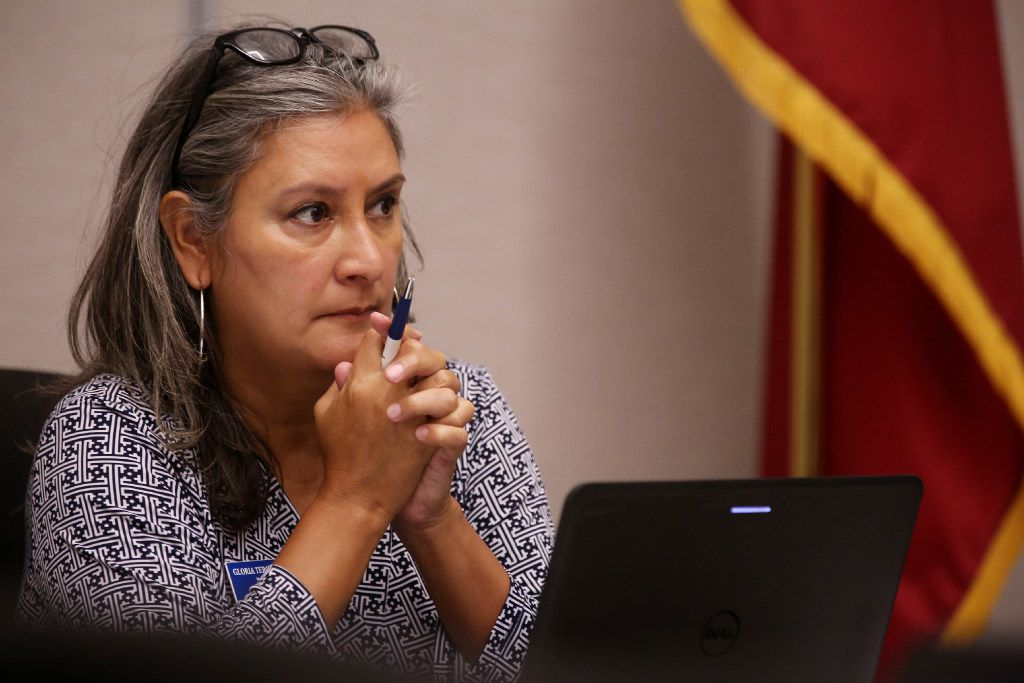 At-large board member Gloria Tercero Levario listens during a Dallas County Schools board of trustees meeting at their headquarters in Dallas on Friday. The board voted for an election for the public to determine whether or not the countywide agency, which provides busing, technology and other service to schools, remains in existence.