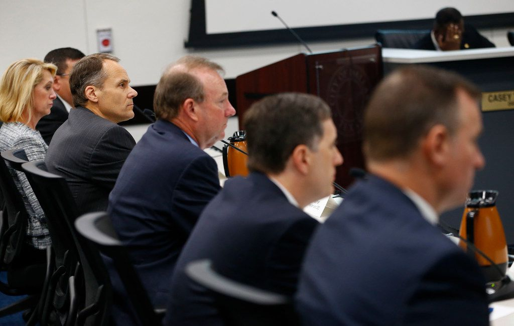 Atmos Energy's president and CEO Mike Haefner (in focus on left) listens at a city council briefing Wednesday at Dallas City Hall.