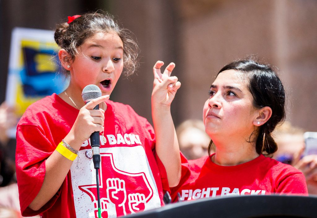Wendy Medrano, left, who represented Workers Defense Project, speaks at a One Texas Resistance rally on the steps of the capitol on the first day of a legislative special session on Tuesday, July 18, 2017 at the Texas state capitol in Austin, Texas. (Ashley Landis/The Dallas Morning News)