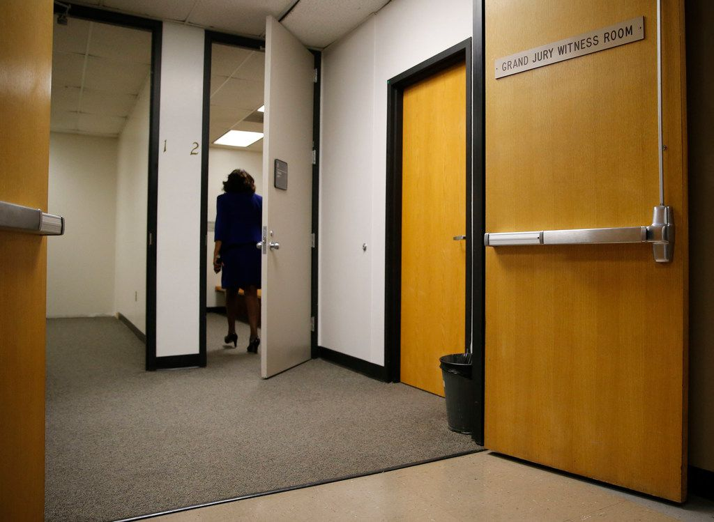 Dallas County District Attorney Faith Johnson enters a grand jury room Wednesday at the courthouse in Dallas.