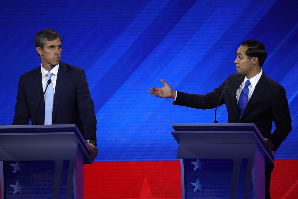 Former Texas Congressman Beto O'Rourke (left) looked on as former federal Housing and Urban Development Secretary Julián Castro challenged former Vice President Joe Biden on health care during Thursday night's Democratic Presidential Debate at Texas Southern University in Houston.