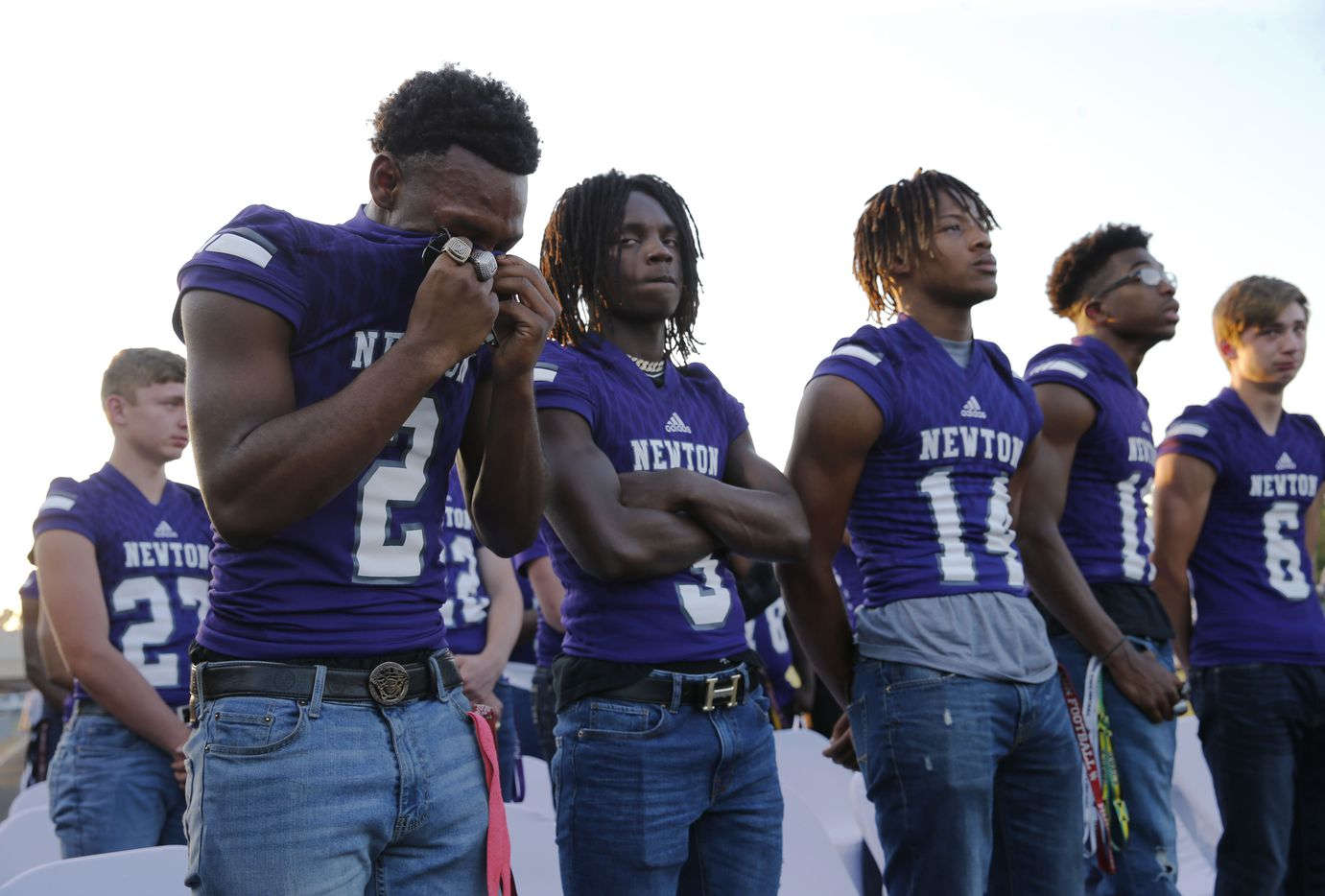 """Newton's Kevin Watson Jr. (2) wipes away tears during the memorial service for Newton High School head football coach William Theodore """"W.T."""" Johnston at Curtis Barbay Field at Newton High School in Newton, Texas on Wednesday, May 15, 2019. (Vernon Bryant/The Dallas Morning News)"""