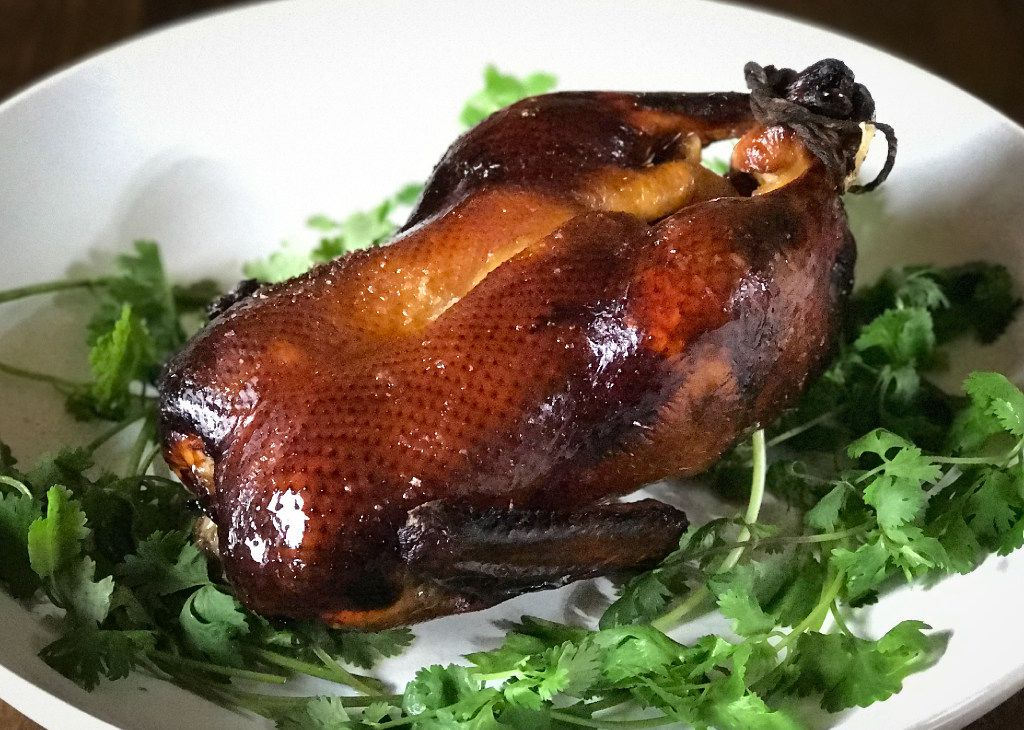 Lacquered roast duck, which makes a stunning centerpiece for a celebratory dinner, is amazingly easy to prepare.