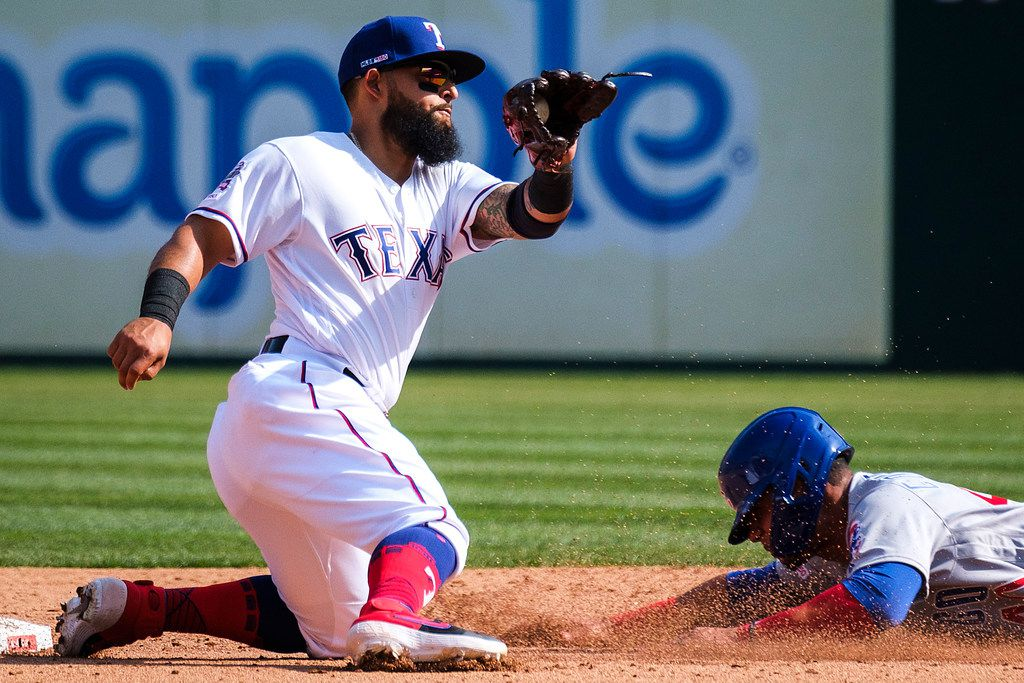 Chicago Cubs catcher Willson Contreras is caught stealing to end the top of the fifth inning as Texas Rangers second baseman Rougned Odor prepares to put down the tag at Globe Life Park on Thursday, March 28, 2019, in Arlington. (Smiley N. Pool/The Dallas Morning News)