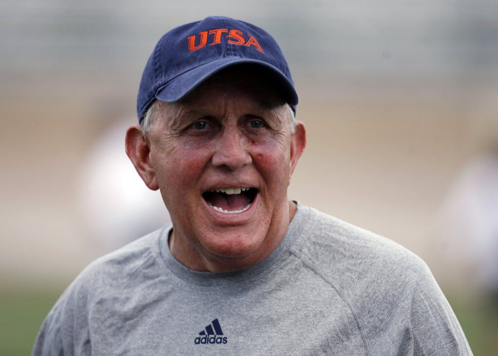 In this photo taken Aug. 7, 2011, Texas-San Antonio coach Larry Coker during the team's first NCAA college football practice of the season at the Dub Farris Athletic Complex football stadium in San Antonio. Coker, the former Miami coach, said he's not letting an NCAA investigation into his old program distract him from getting UTSA ready for its college football debut. UTSA plays its first game Saturday, Sept. 3, 2011, in the Alamodome. (AP Photo/San Antonio Express-News, Omar Perez) 09022011xSPORTS