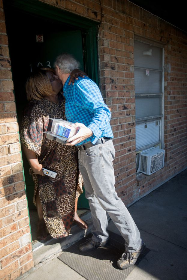 Guy Reynolds gets a hug and kiss from client Mildred Harris as he delivers a Meals on Wheels route in South Dallas on Thursday, March 30, 2017. Reynolds used to see Harris every Monday and Tuesday but now just does routes occasionally after his hours changed at work. (Allison V. Smith/Special Contributor)