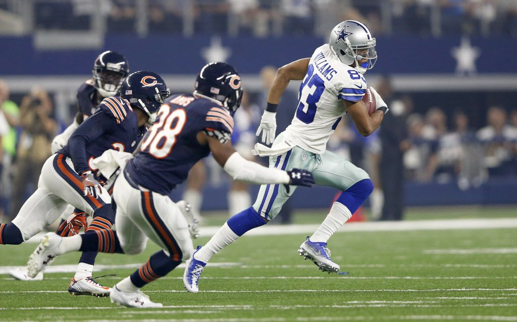 Dallas Cowboys wide receiver Terrance Williams (83) runs after the catch as Chicago Bears cornerback Jacoby Glenn (39) and Chicago Bears free safety Adrian Amos (38) chases after him during the first half of play at AT&T Stadium in Arlington on Sunday, September 25, 2016. (Vernon Bryant/The Dallas Morning News)