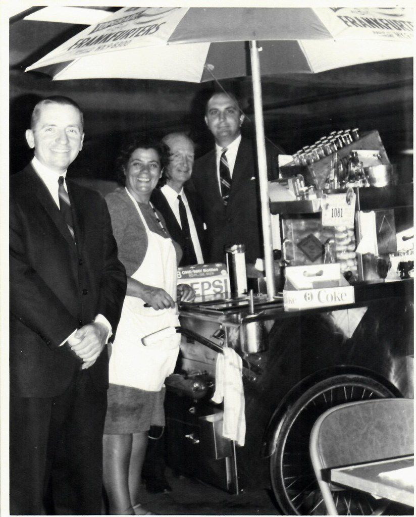 """Ross Perot, left, with New York City hot dog vendor Rudy Smutny and Ken Langone, who was with the brokerage firm, R. W. Pressprich, that handled the EDS's first public offering in 1968. Langone hired the hot dog stand for EDS' """"big"""" IPO luncheon, telling Perot that they were going to the """"exclusive"""" Umbrella Club. ."""