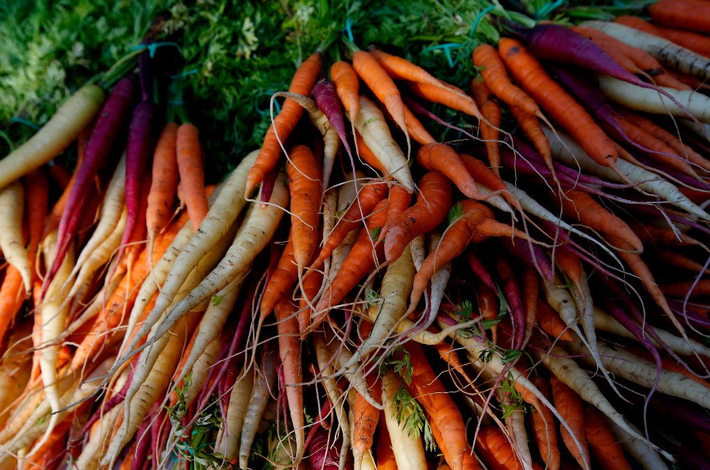 Carrots for sale at the stand of Megan Neubauer of Pure Land Organic at the Historic McKinney Farmers Market.