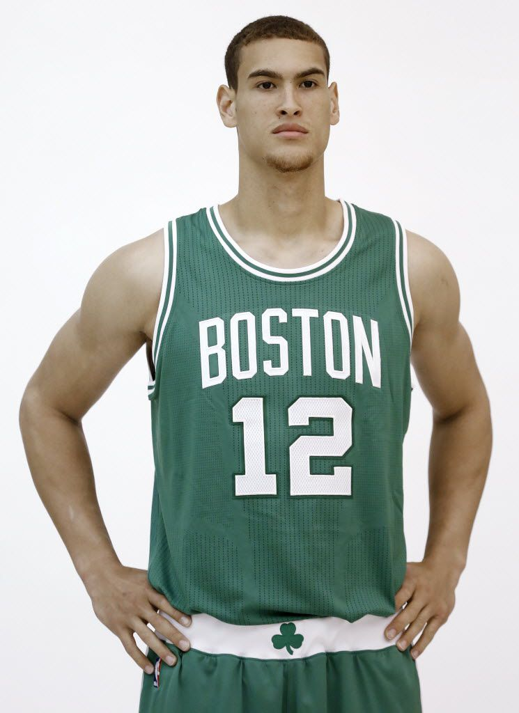 Boston Celtics forward Dwight Powell poses for a camera during NBA team media day, Monday, Sept. 29, 2014, in Waltham, Mass. (AP Photo/Steven Senne) ORG XMIT: MASR1