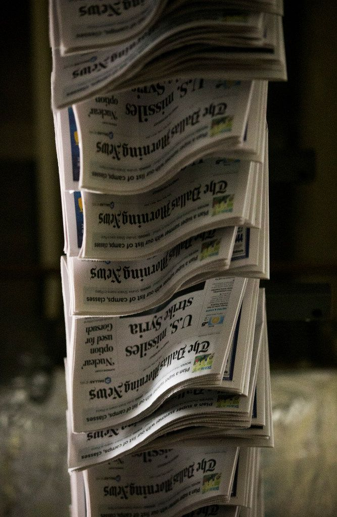Copies of The Dallas Morning News move through the company's printing plant in Plano.