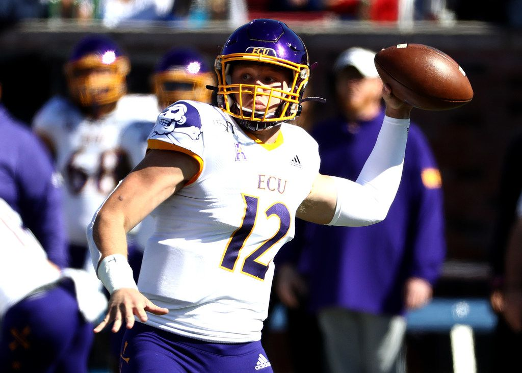 DALLAS, TEXAS - NOVEMBER 09:  Holton Ahlers #12 of the East Carolina Pirates throws against the Southern Methodist Mustangs in the first half at Gerald J. Ford Stadium on November 09, 2019 in Dallas, Texas. (Photo by Ronald Martinez/Getty Images)
