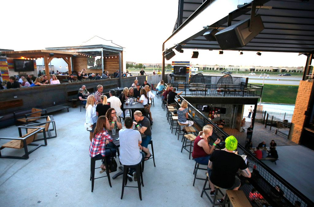 The outdoor patio overlooking the main stage at Lava Cantina in The Colony, Texas, Thursday, May 11, 2017.