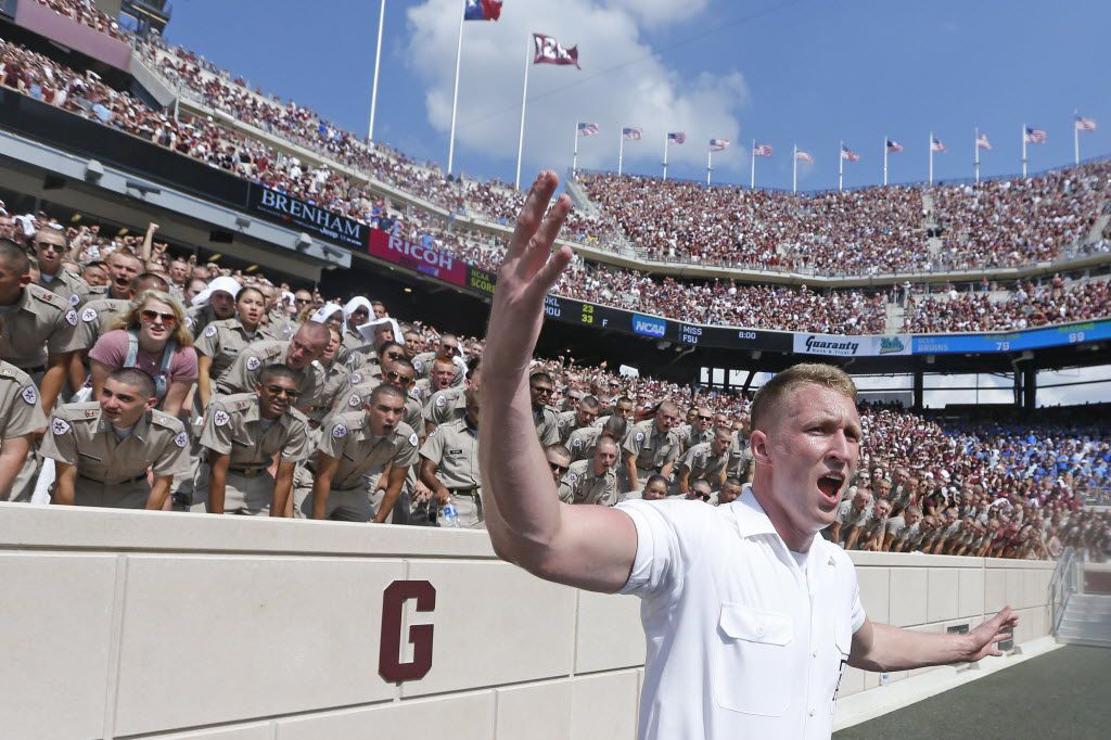 An Aggie yell leader leads the cheers during the UCLA Bruins vs. the Texas A&M Aggies NCAA football game at Kyle Field in College Station, Texas on Saturday, September 3, 2016. (Louis DeLuca/The Dallas Morning News)