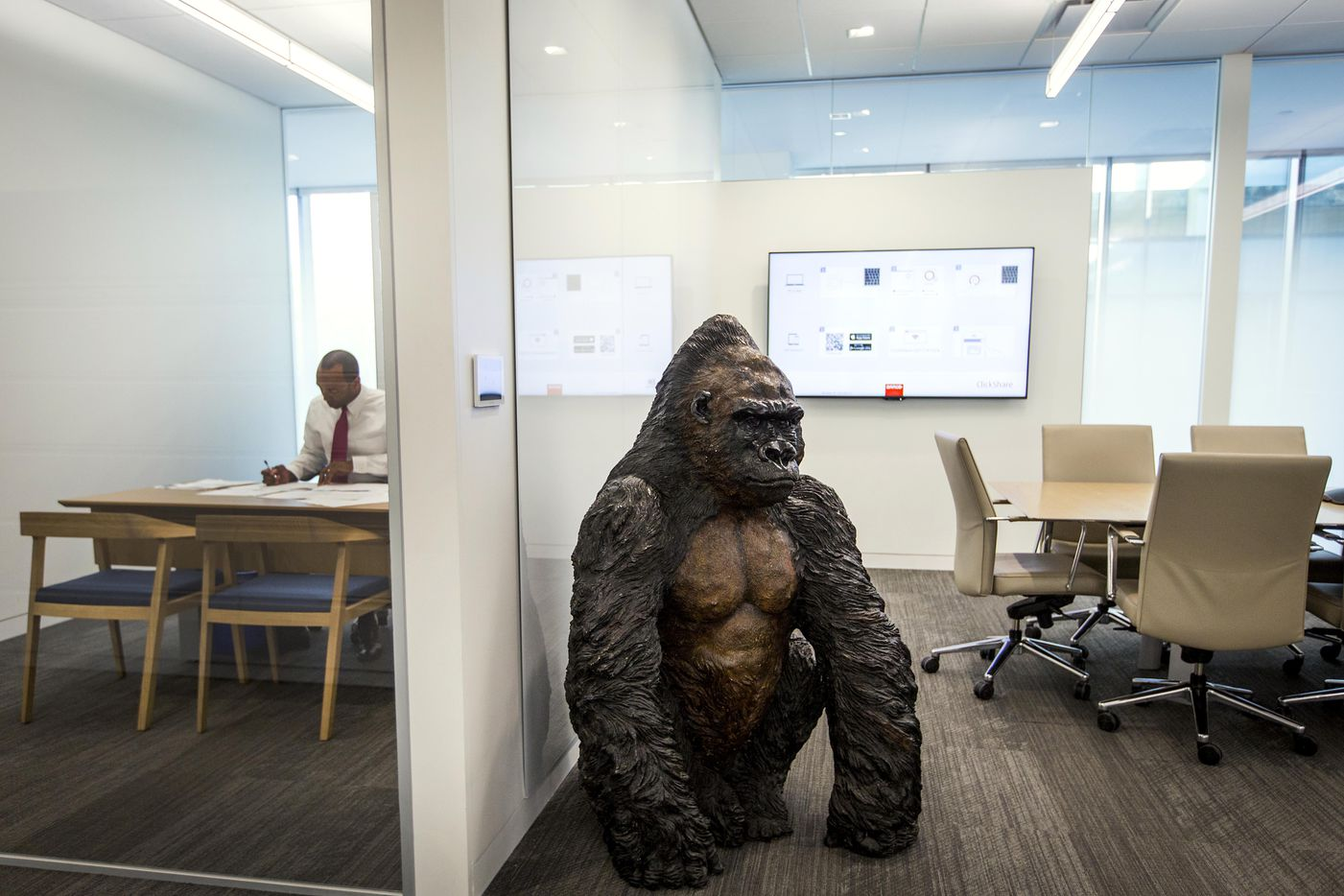 Perot company team members who close a major deal get a big gorilla statue outside their office door to signal success.