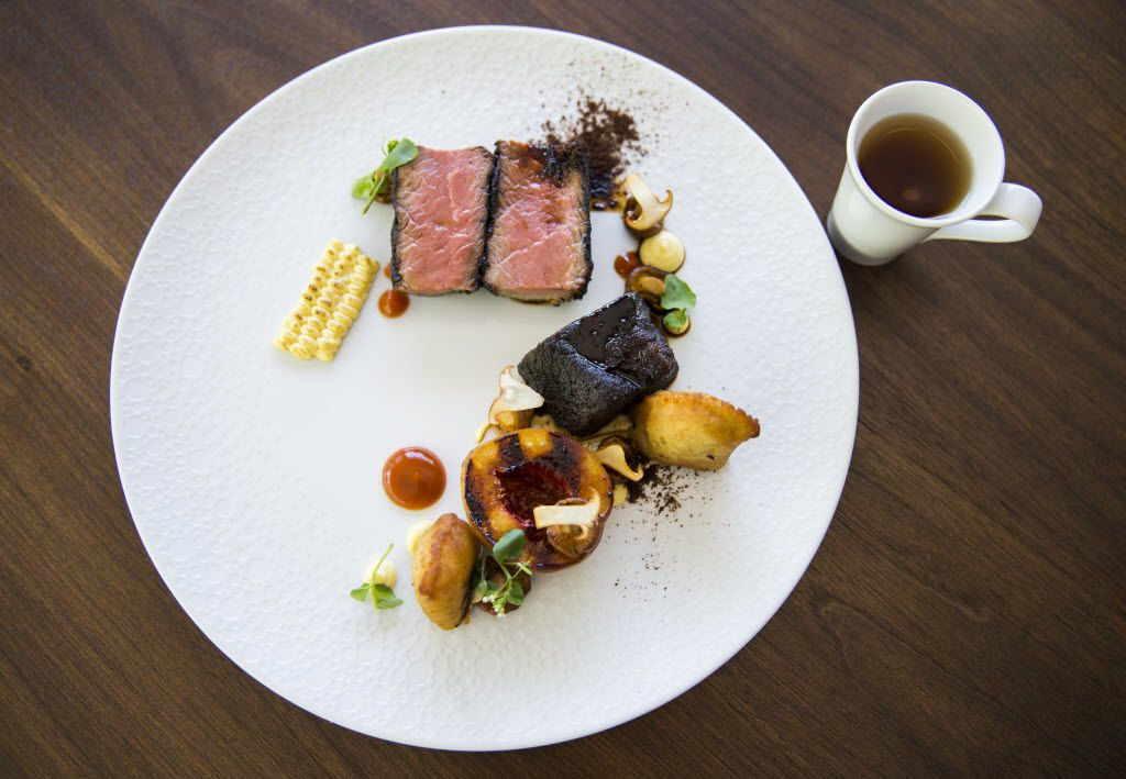 Loin of South Texas nilgai antelope with smoked and braised rib, huitlacoche empanada, roasted chanterelles, grilled peach and dehydrated mole dust