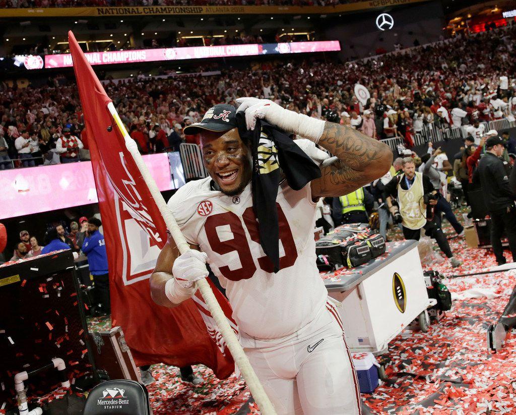 Alabama's Raekwon Davis celebrates after overtime of the NCAA college football playoff championship game against Georgia, Monday, Jan. 8, 2018, in Atlanta. Alabama won 26-23. (AP Photo/David Goldman)