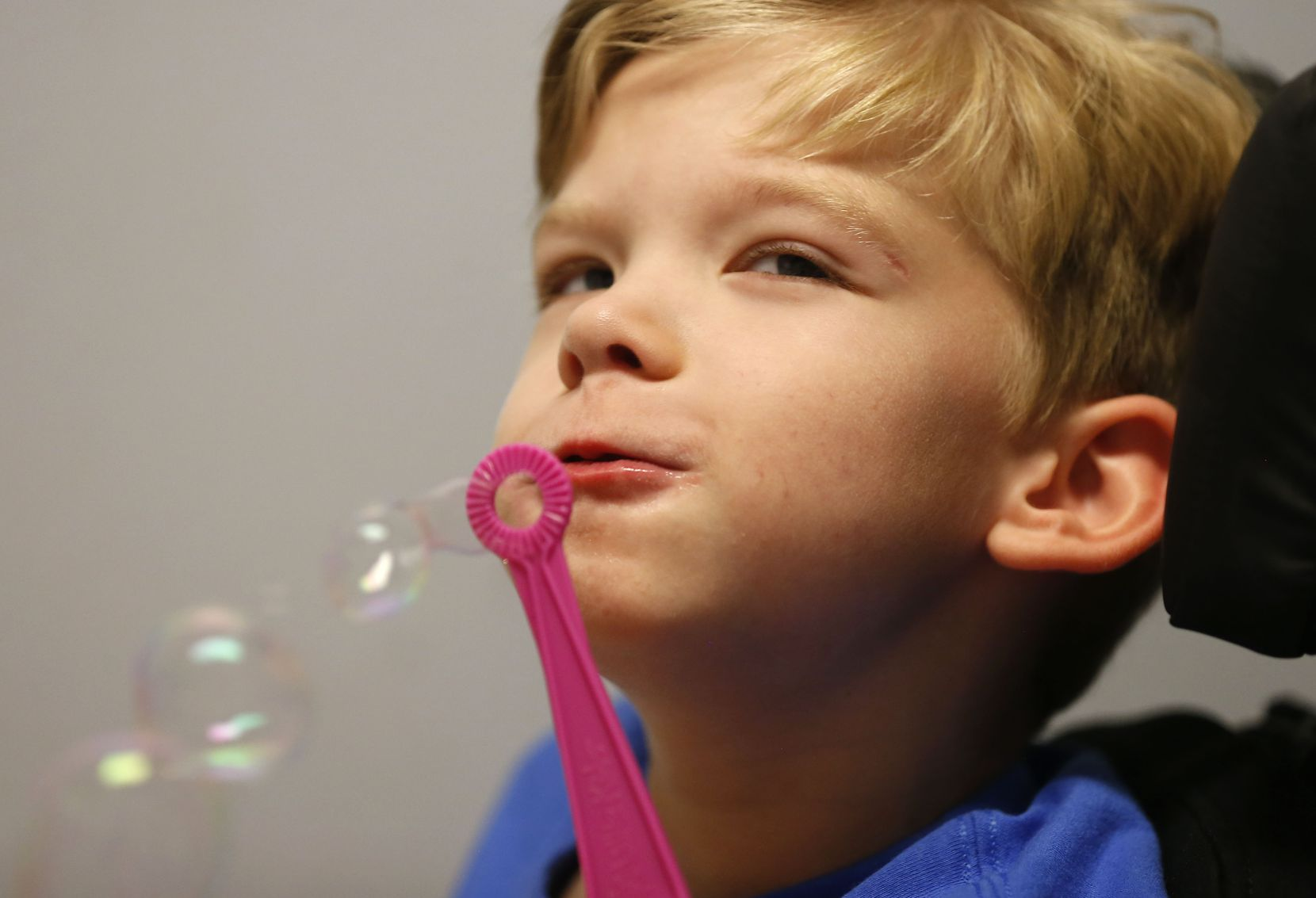 Will blows bubbles at Keystone Pediatric Therapy in McKinney, Texas, Wednesday, June 20, 2018.