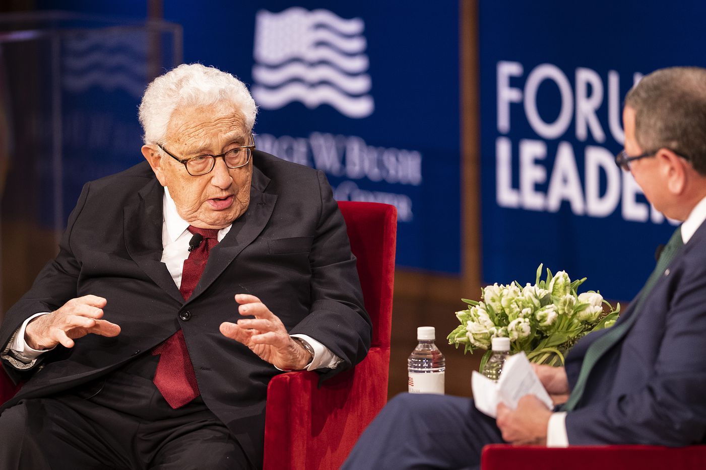 "Dr. Henry Kissinger talks with moderator Ken Hersh during a keynote conversation titled ""The New World Order"" at the Forum on Leadership at the George, W. Bush Presidential Center on Thursday, April 11, 2019, in Dallas. (Smiley N. Pool/The Dallas Morning News)"