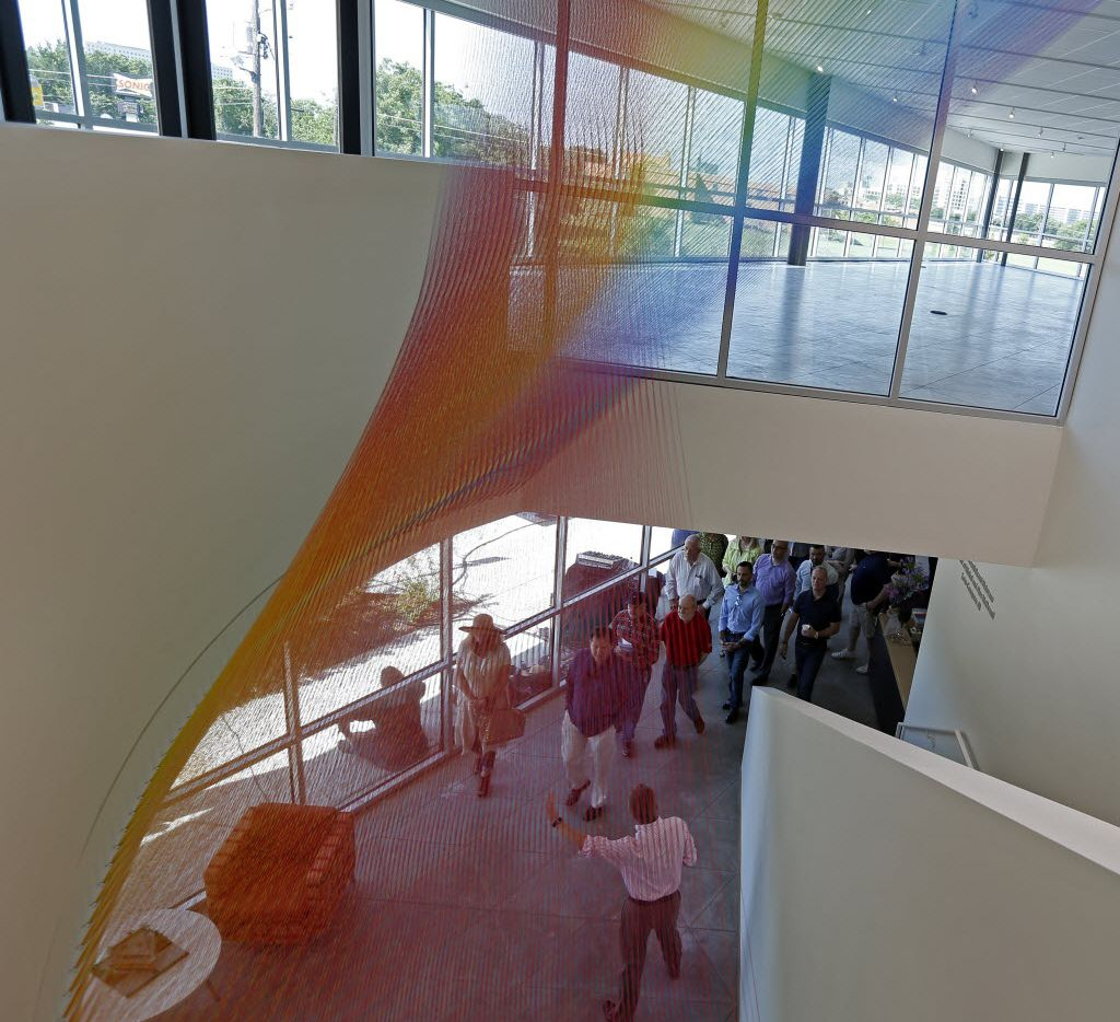 """Visitors touring the new Resource Center passed underGabriel Dawe's string-art piece """"Plexus"""" during Saturday's open house.(Nathan Hunsinger/Staff Photographer)"""