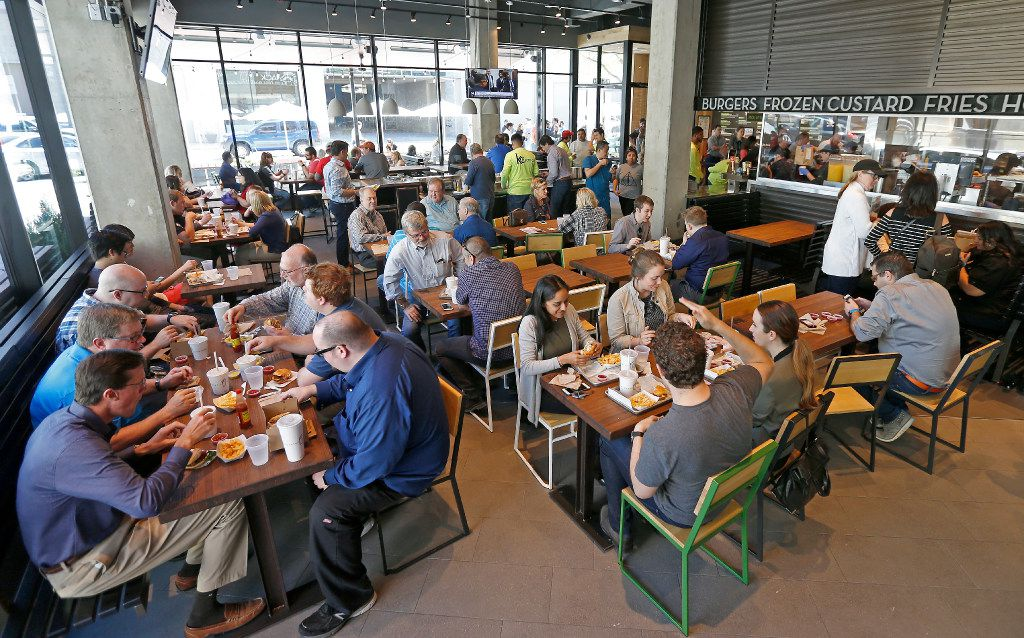 Diners eat lunch at Shake Shack that opens its store in the mixed-use Legacy West development in Plano, Texas, Wednesday, March 29, 2017. (Jae S. Lee/The Dallas Morning News)
