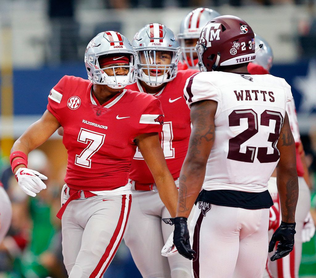 Arkansas Razorbacks wide receiver Jonathan Nance (7) taunts Texas A&M Aggies defensive back Armani Watts (23) after scoring a fourth quarter touchdown at AT&T Stadium in Arlington, Saturday, September 23 2017. Watts made the game-winning stop in overtime as the Aggies defeated the Razorbacks, 50-43. (Tom Fox/The Dallas Morning News)