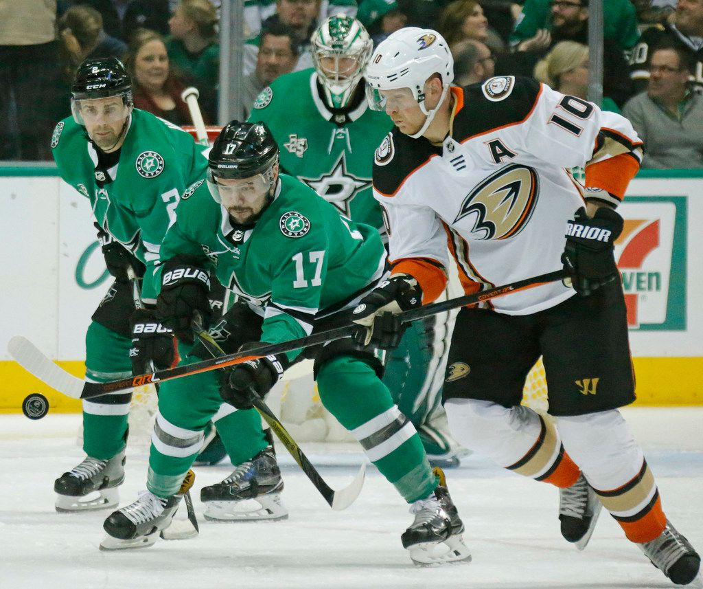 Dallas Stars center Devin Shore (17) and Anaheim Ducks right wing Corey Perry (10) chase the puck in the first period during the Anaheim Ducks vs. the Dallas Stars NHL hockey game at the American Airlines Center in Dallas on Friday, March 9, 2018. (Louis DeLuca/The Dallas Morning News)