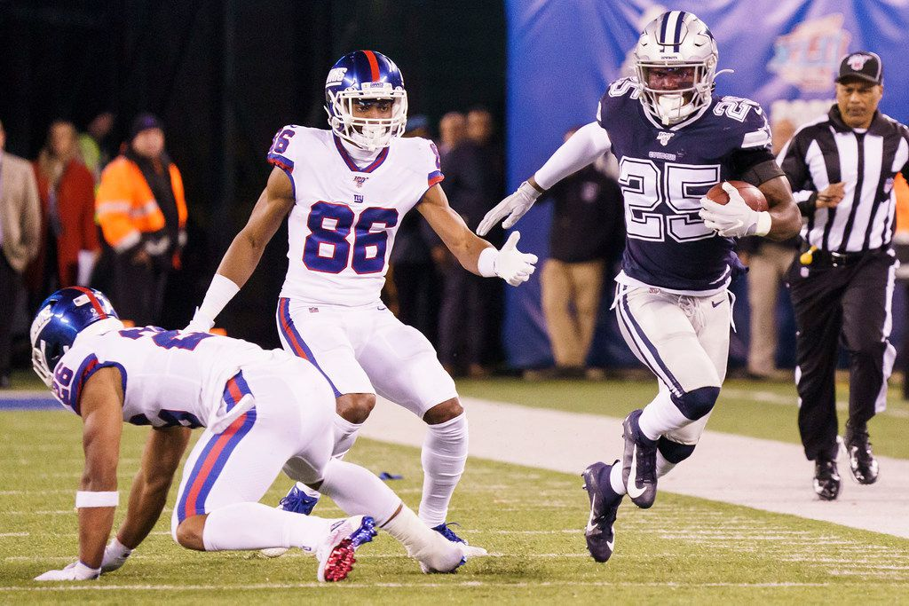Dallas Cowboys free safety Xavier Woods (25) returns an interception on a pass intended for New York Giants wide receiver Darius Slayton (86) during the first half of an NFL football game, Monday, Nov. 4, 2019, in East Rutherford, N.J. . (Smiley N. Pool/The Dallas Morning News)