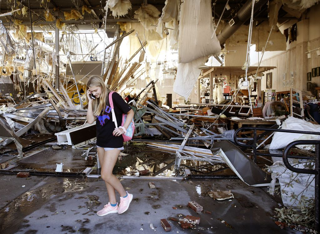 SampleHouse Candleshop employee Chloe Flabiano phones a fellow employee giving her an update on the destroyed Preston Royal shopping center store in Dallas, Monday, October 21, 2019. A tornado tore through the entire shopping center. (Tom Fox/The Dallas Morning News)