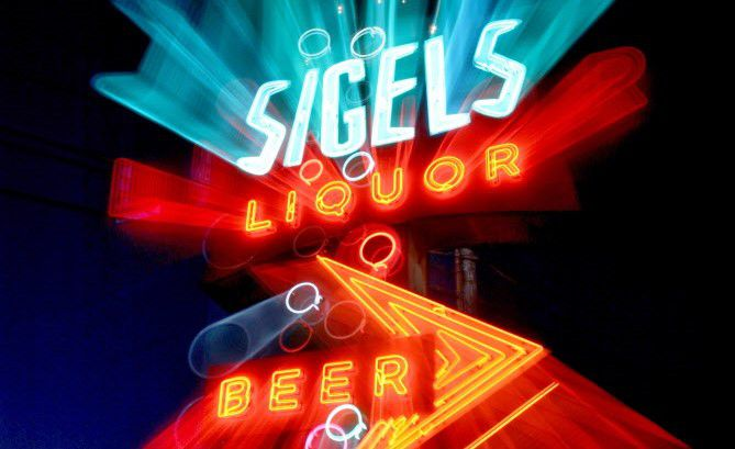 Sigel's Liquor store at Lemmon and Inwood is slated for closing soon after losing its lease. The old neon sign in front of the store is one of the few things there not for sale. (Guy Reynolds/The Dallas Morning News)