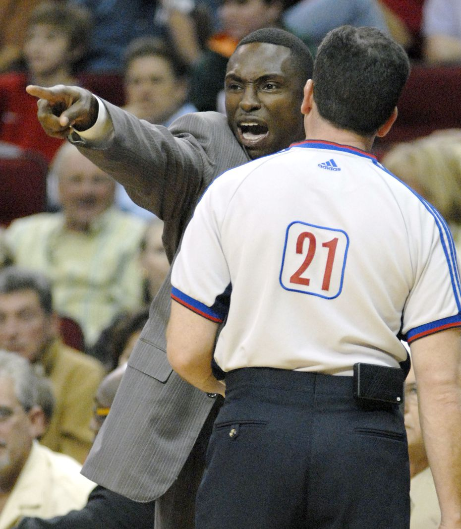 FILE - Mavericks coach Avery Johnson displays his displeasure with referee Tim Donaghy (21), saying that the Rockets should have been called for fouling Dirk Nowitzki, during the first quarter of a game on Saturday, Nov. 4, 2006, in Houston. (AP Photo/Tim Johnson)